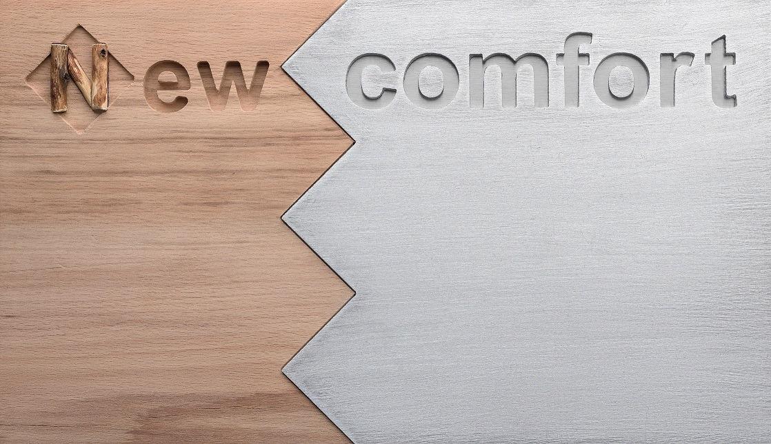 """Grafik mit einer Kombination aus Holz und Metall und dem Schriftzug """"New comfort"""""""