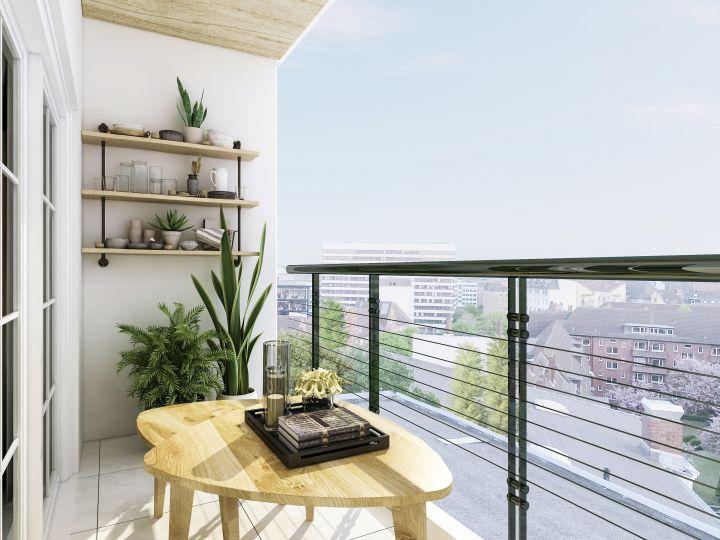 Man erkennt einen kleinen Tisch auf einem Balkon.