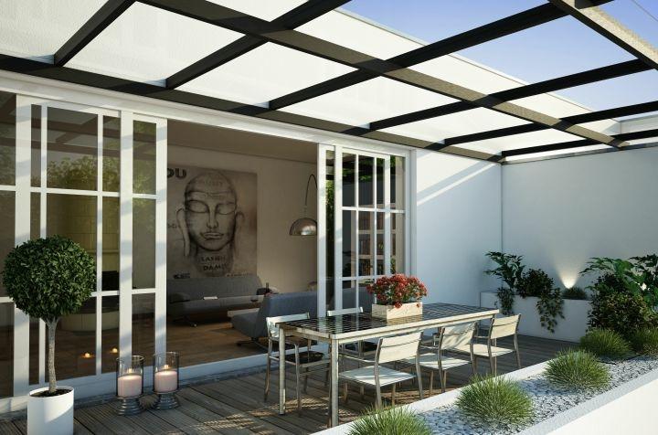 Moderne Sichtschutz Terrasse mit Überdachung, großer Esstisch mit Sesseln, verschiedenste Dekoelemente